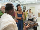 Aliana Grace Bailey listens to Tunde Odunlade. Photo: Amy Staples