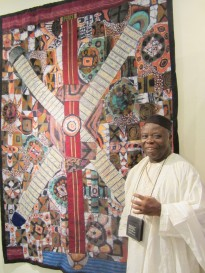 """Tunde with """"Universal Peace Lies in Cultural Rearmament."""" Photo: Amy Staples"""