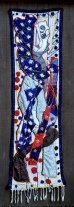 "Title: Faceless Entertainer Medium: Beaded Batik Quilt Tapestry Date: 2018 74 x 21"" $6,900"